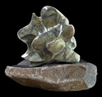 Rising Tide - Serpentinite on black granite base